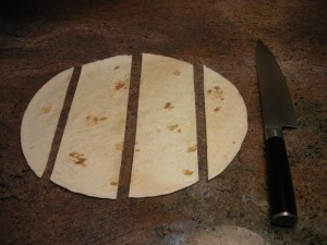 "Cut tortillas into 3"" wide strips."