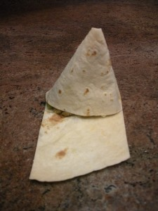 Fold tortilla around filling into a triangle.