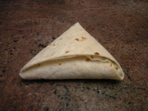 Tuck tortilla end into pocket.