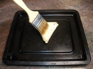 Place samosa on baking sheet.